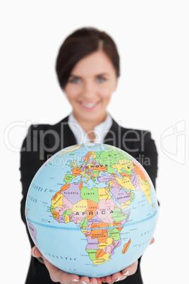 Brunette businesswoman holding an earth globe