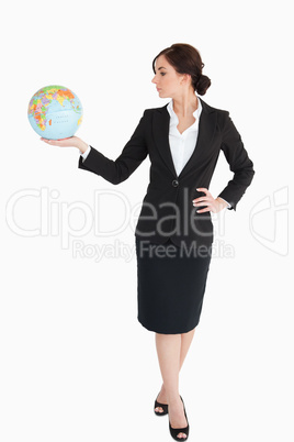 Attractive businesswoman holding an earth globe
