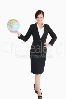 Happy businesswoman holding an earth globe