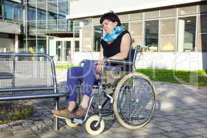 Woman tries to sit in a wheelchair