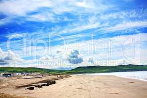 Girvan,  Scotland, sunny beach with people relaxing