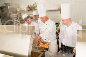 Professional chef cook prepare food in kitchen