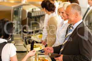 Cafeteria business man pay by credit card cashier