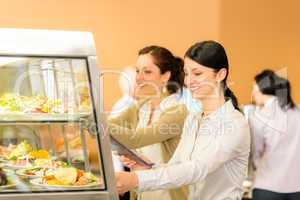 Cafeteria lunch young woman take salad plate
