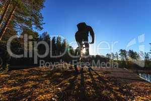 Biker Riding in Forest