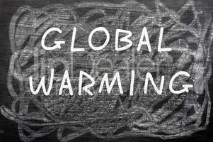 """""""Global Warming"""" written on a chalkboard"""