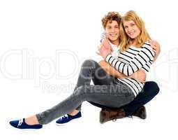 Girlfriend sitting on her partners lap