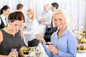 Business meeting buffet smiling woman eat dessert