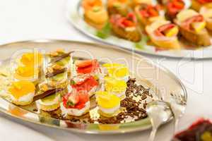 Appetizers mini desserts on catering buffet plate