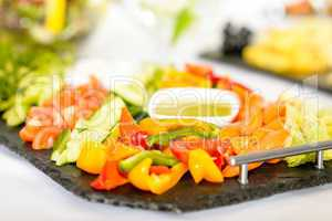 Selection of fresh vegetables with dips