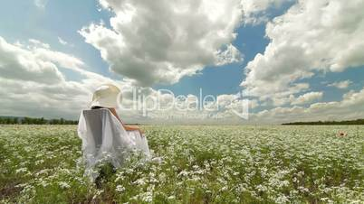 DOLLY:  Young Woman On White Field In Summer