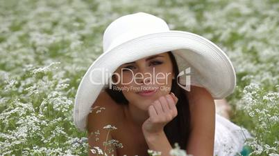 Smiling Face Of Young Woman In Field