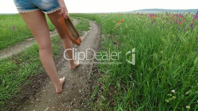 Young Woman Walking Down A Country Road
