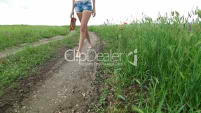 Young Woman Walking A Country Road