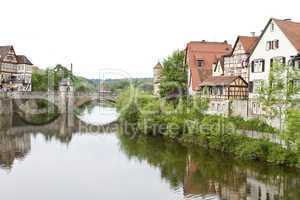 historic city in germany with river and stone bridge