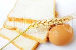 Bread, wheat ear and egg