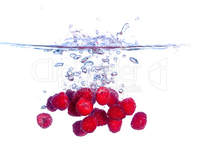 Red Raspberries Falls under Water with a Splash