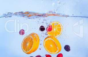 Fresh Fruit Falls under Water with a Splash