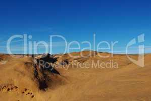 Beautiful orange rock hills under blue skies, Grand Stair Escalante National Monument, Utah