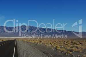 Highway to salt flats and high mountain chain, Nevada desert