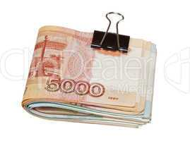 Folded rouble bills isolated on white background
