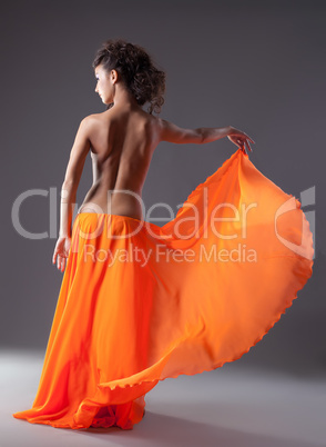 woman dance in orange veil with naked spine