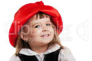 Child in Little Red Riding Hood portrait isolated