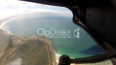 Helicopter Flying along Coast Cape Town