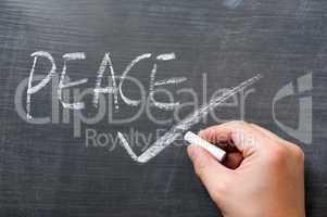 Peace - word written on a blackboard