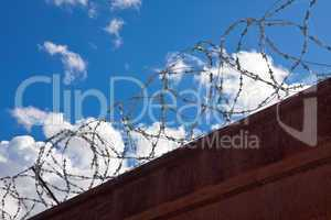 Barbed wire on a background of blue sky.