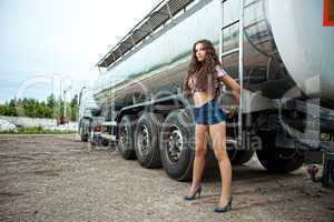 Brunette young woman and truck