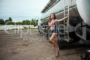 Sexy young woman and truck
