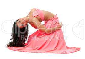 Smiling oriental dancer in pink costume