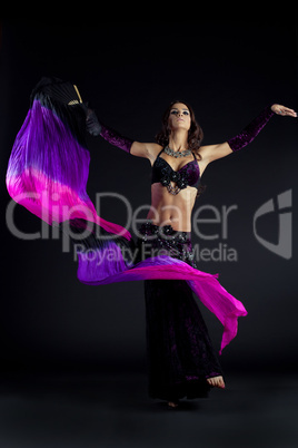 Beautiful young woman dancing oriental dance