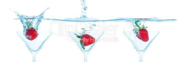 Collage Fresh Strawberry Dropped into Glass with Splash