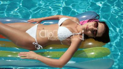 Bikini Woman on Air Bed In Swimming Pool