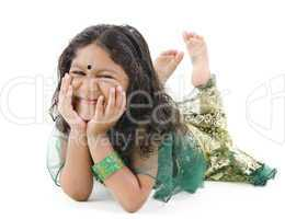 Little Indian girl lying on floor