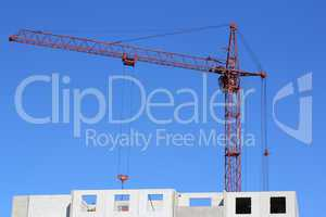red crane and blue sky on building site