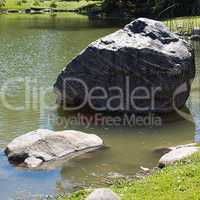 Japanese pond with carps and stones