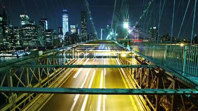 city traffic on Brooklyn bridge at night. Time lapse and loopable