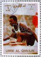 Postage stamp Umm al-Quwain 1972 Long Jump, Summer Olympics, Mun