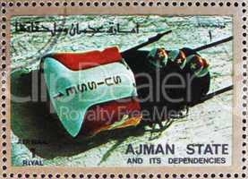 Postage stamp Ajman 1973 Four-man Bobsled, Winter Olympics
