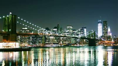 Beautiful view of Manhattan skyline and Brooklyn bridge at night. Time lapse and loopable