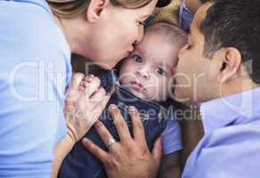 Mixed Race Parent Kissing Their Son