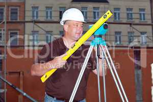Civil engineer with leveling
