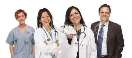 Hispanic Female Doctor or Nurse with Baby Shoes and Support Staf