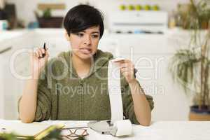 Mixed Race Young Female Agonizing Over Financial Calculations
