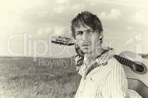 Toned image of country guitar player