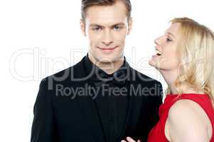 Woman whispering something to her sweetheart