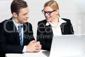 Businessman discussing deal with secretary
